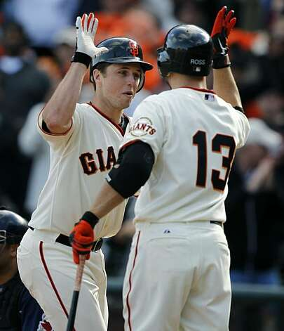 Buster Posey celebrates his eighth inning blast with Cody Ross in the Giants' 3-0 win over the San Diego Padres on Sunday. Photo: Paul Chinn, The Chronicle