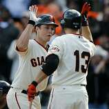 Buster Posey celebrates his eighth inning blast with Cody Ross in the Giants' 3-0 win over the San Diego Padres on Sunday.