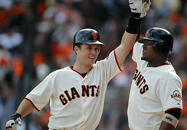 Buster Posey celebrates his eighth inning homer with Juan Uribe in the Giants' 3-0 win over the San Diego Padres on Sunday. Photo: Paul Chinn, The Chronicle
