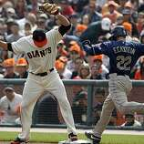 Freddy Sanchez beats David Eckstein to first base in the first inning of the San Francisco Giants game against the San Diego Padres at AT&T Park on Sunday.