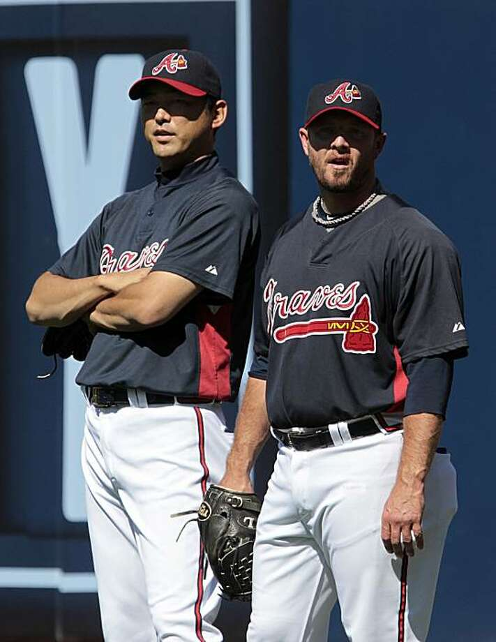 Injured Atlanta Braves closer Billy Wagner, right, talks with fellow pitcher Takashi Saito, left, prior to Game 3 of the Braves' National League Division Series baseball matchup against the San Francisco Giants at Turner Field in Atlanta on Sunday, Oct. 10, 2010. Photo: Dave Martin, AP