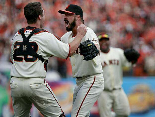 Closer Brian Wilson (right) embraces catcher Buster Posey after the Giants defeated the San Diego Padres to win the National League West championship Sunday. Photo: Brant Ward, The Chronicle