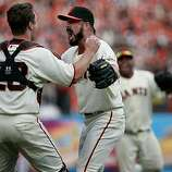 Closer Brian Wilson (right) embraces catcher Buster Posey after the Giants defeated the San Diego Padres to win the National League West championship Sunday.