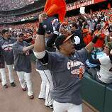 Giants players celebrate the NL West title with fans at AT&T Park on Sunday.