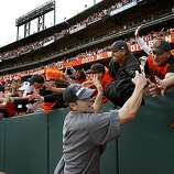 Freddie Sanchez shakes hands with Giants fans down the left field line  Sunday.