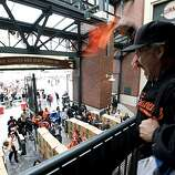"""Chris Duckart screams """"Let's go Giants!"""" and waves his rally towel at the crowd below prior to the San Francisco Giants' game against the San Diego Padres at AT&T Park on Sunday."""