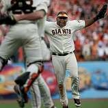 Pablo Sandoval celebrates the final out against the San Diego Padres to win the National League West championship Sunday.