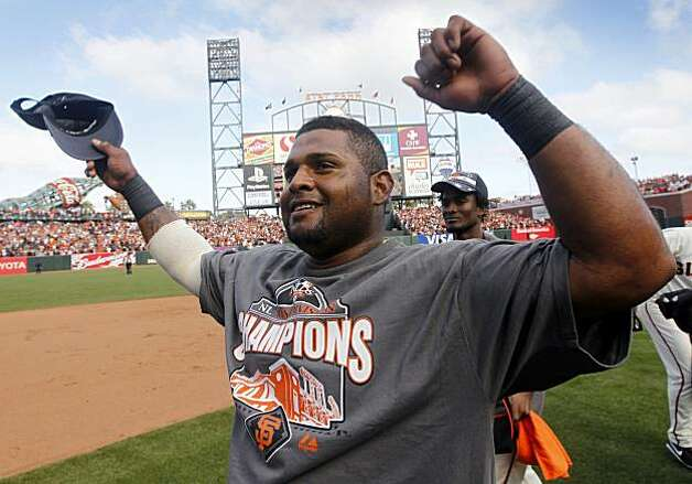 Pablo Sandoval celebrates the Giants' 3-0 win over the San Diego Padres and the NL West title at AT&T Park on Sunday. Photo: Paul Chinn, The Chronicle