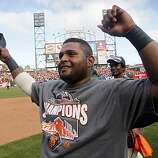 Pablo Sandoval celebrates the Giants' 3-0 win over the San Diego Padres and the NL West title at AT&T Park on Sunday.