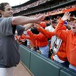 Pat Burrell makes his way down a group of appreciative fans after the game Sunday.
