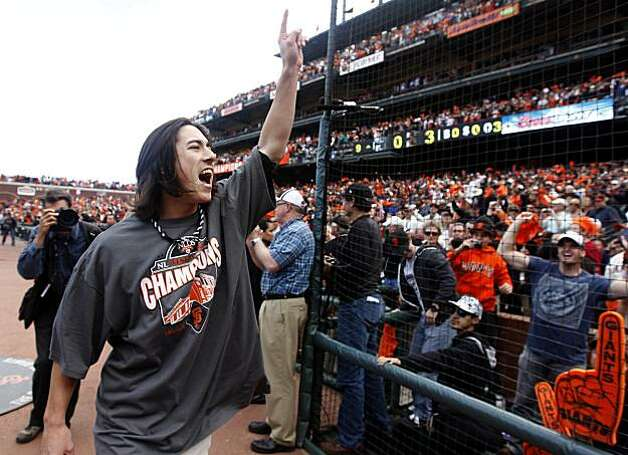 Tim Lincecum celebrates with fans after the Giants' 3-0 win over the San Diego Padres and the NL West title at AT&T Park on Sunday. Photo: Paul Chinn, The Chronicle