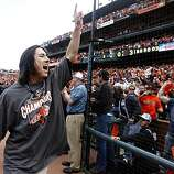 Tim Lincecum celebrates with fans after the Giants' 3-0 win over the San Diego Padres and the NL West title at AT&T Park on Sunday.