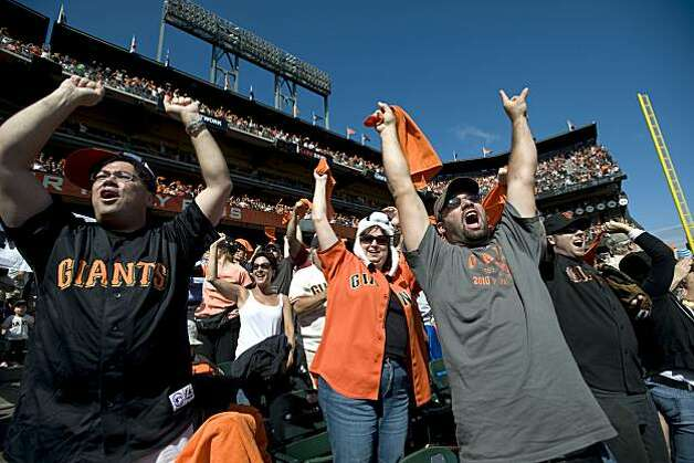 Fans go crazy as the Giants score two runs in the bottom of the third inning at AT&T Park on Sunday. Photo: Chad Ziemendorf, The Chronicle