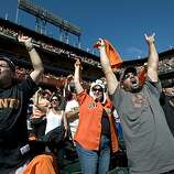 Fans go crazy as the Giants score two runs in the bottom of the third inning at AT&T Park on Sunday.