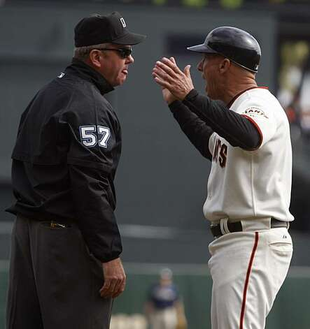Third base coach Tim Flannery argues with umpire Mike Everitt, who called Andres Torres' drive down the third base line foul in the first inning of the San Francisco Giants game against the San Diego Padres at AT&T Park on Sunday. Photo: Paul Chinn, The Chronicle