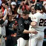 Buster Posey is welcomed back to the dugout after his eighth inning home run Sunday.