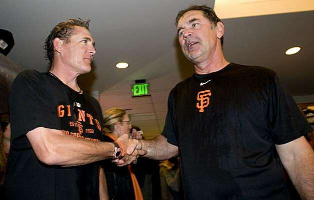 Dave Righetti (left) shakes the hand of Bruce Bochy as the San Francisco Giants celebrate their National League West Championship after defeating the San Diego Padres at AT&T Park on Sunday. Photo: Chad Ziemendorf, The Chronicle