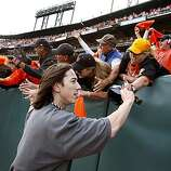Giants pitcher Tim Lincecum is greeted down the left field line after the victory Sunday.