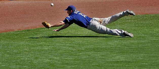 San Diego Padres centerfielder Chris Denorfia dives for Aubrey Huff's hit, which gave the Giants a two-run lead in the third inning Sunday in San Francisco. Photo: Lacy Atkins, The Chronicle