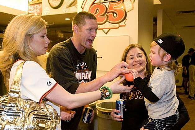 Aubrey Huff and his wife, Baubi, play with their son, Jayce, held by Baubi's mother, Naomi Price, as the San Francisco Giants celebrate their National League West Championship after defeating the San Diego Padres at AT&T Park on Sunday. Photo: Chad Ziemendorf, The Chronicle