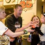 Aubrey Huff and his wife, Baubi, play with their son, Jayce, held by Baubi's mother, Naomi Price, as the San Francisco Giants celebrate their National League West Championship after defeating the San Diego Padres at AT&T Park on Sunday.