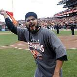 Reliever Sergio Romo celebrates the Giants' 3-0 win over the San Diego Padres and the NL West title at AT&T Park on Sunday.