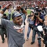 Pablo Sandoval celebrates the Giants' NL West title at AT&T Park on Sunday.