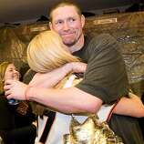 Aubrey Huff hugs his wife, Baubi, as the San Francisco Giants celebrate their National League West Championship after defeating the San Diego Padres at AT&T Park on Sunday.