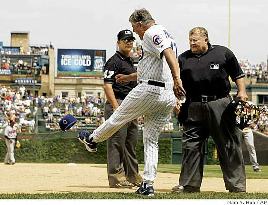 Chicago Cubs manager Lou Piniella, center, kicks his hat as he argues with third base umpire Mark Wegner, left, and home plate umpire Bruce Froemming watches during the eighth inning of a baseball game against Atlanta Braves, Saturday, June 2, 2007, in Chicago. Lou Piniella was ejected by 3B umpire Mark Wegner.(AP Photo/Nam Y. Huh) Ran on: 06-03-2007 Lou Piniella's Cubs haven't shown much kick this season, but he still has some power in his legs Photo: Nam Y. Huh, AP