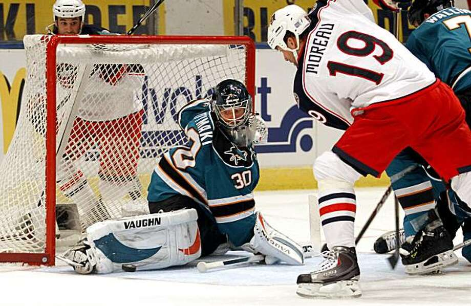 San Jose Sharks' goalie Antero Nittymaki (left), of Finland, makes a save on Columbus Blue Jackets' Ethan Moreaus' shot, during the first period of a NHL hockey game, in Stockholm, Sweden, Saturday, Oct. 9, 2010. Photo: Niklas Larsson, AP