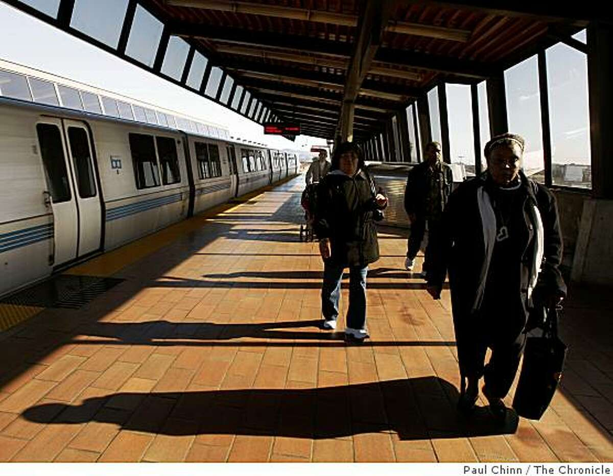 Passengers arriving at the Fruitvale BART station head for the exit in Oakland, Calif., on Thursday, Jan. 29, 2009.