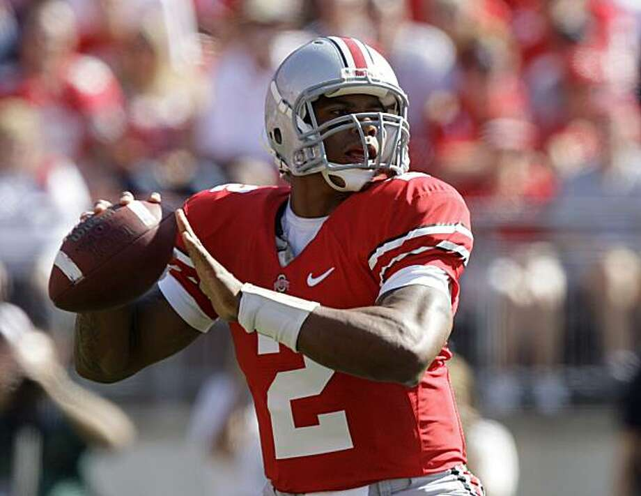 Ohio State's Terrelle Pryor drops back to pass against Indiana during the first quarter of an NCAA college football game, Saturday, Oct. 9, 2010, in Columbus, Ohio. Photo: Jay LaPrete, AP