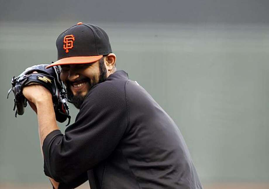 Giants relief pitcher, Sergio Romo can't keep a straight face during a practice pitching drill on Tuesday. The San Francisco Giants practiced AT&T Park in San Francisco, Calif., on Tuesday, October 5, 2010, in preparation for their National League Division Series against the Atlanta Braves. Photo: Carlos Avila Gonzalez, The Chronicle
