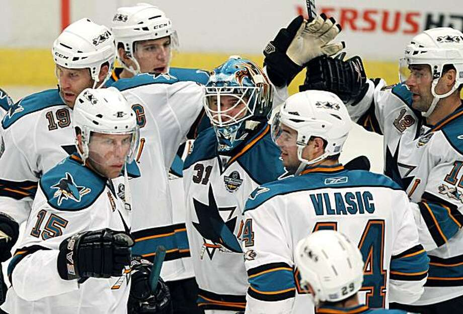 San Jose Sharks' players Joe Thornton (19) Dany Heatley (15) Antti Niemi (31) of Finland, Marc-Edouard Vlasic (44) Patrick Marleau (12) react, after the third period of a NHL hockey game against Columbus Blue Jackets, in Stockholm, Sweden, Friday, Oct. 8,2010. Photo: Nlx, AP
