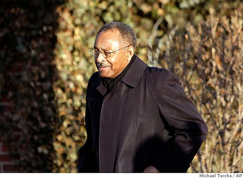Sen. Roland Burris leaves his South Side home Friday, Feb. 20, 2009, in Chicago. Gov. Pat Quinn called Friday for fellow Democrat Roland Burris to resign from the U.S. Senate and implored Illinois lawmakers to quickly pass a law setting up a special election to fill any vacancy. (AP Photo/The Chicago Tribune, Michael Tercha) ** CHICAGO LOCALS OUT, ROCKFORD REGISTER STAR OUT, MAGS OUT, NO SALES, TV OUT ** Photo: Michael Tercha, AP