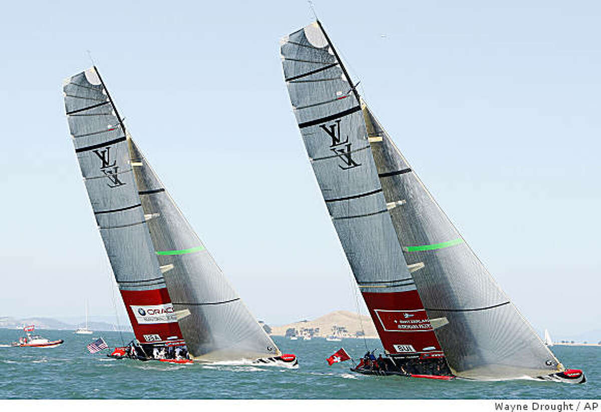 In this Feb. 8, 2009 photo, Alinghi of Switzerland, right, leads Oracle of the United States on the way to mark one of their race on day 4 of round robin 2 of the Louis Vuitton Pacific Series sailing race in Auckland, New Zealand. Oral arguments are scheduled for Tuesday, Feb. 10, 2009 before the New York State Court of Appeals in Albany in the bitter case between San Francisco's Golden Gate Yacht Club, which backs Ellison's BMW Oracle Racing, and Societe Nautique de Geneve, the Swiss club that backs Bertarelli's two-time defending America's Cup champion Alinghi.