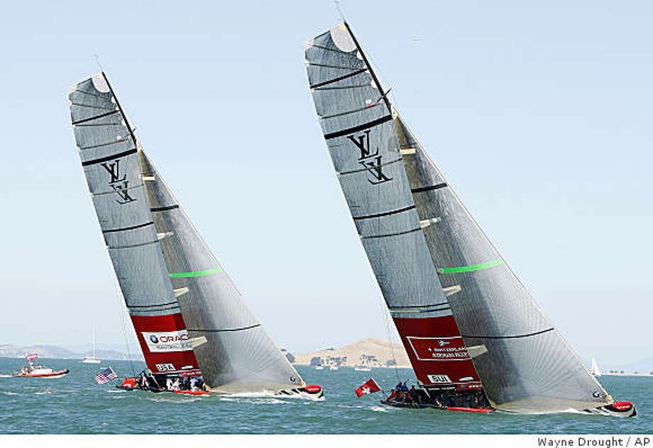 In this  Feb. 8, 2009 photo, Alinghi of Switzerland, right, leads Oracle of the United States on the way to mark one of their race on day 4 of round robin 2 of the Louis Vuitton Pacific Series sailing race in Auckland, New Zealand.   Oral arguments are scheduled for Tuesday, Feb. 10, 2009  before the New York State Court of Appeals in Albany in the bitter case between San Francisco's Golden Gate Yacht Club, which backs Ellison's BMW Oracle Racing, and Societe Nautique de Geneve, the Swiss club that backs Bertarelli's two-time defending America's Cup champion Alinghi. Photo: Wayne Drought, AP