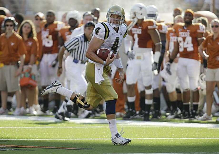 UCLA's Kevin Prince runs for a touchdown against Texas during the fourth quarter on an NCAA college football game, Saturday, Sept. 25, 2010 in Austin, Texas. UCLA won 34-12. Photo: Eric Gay, AP