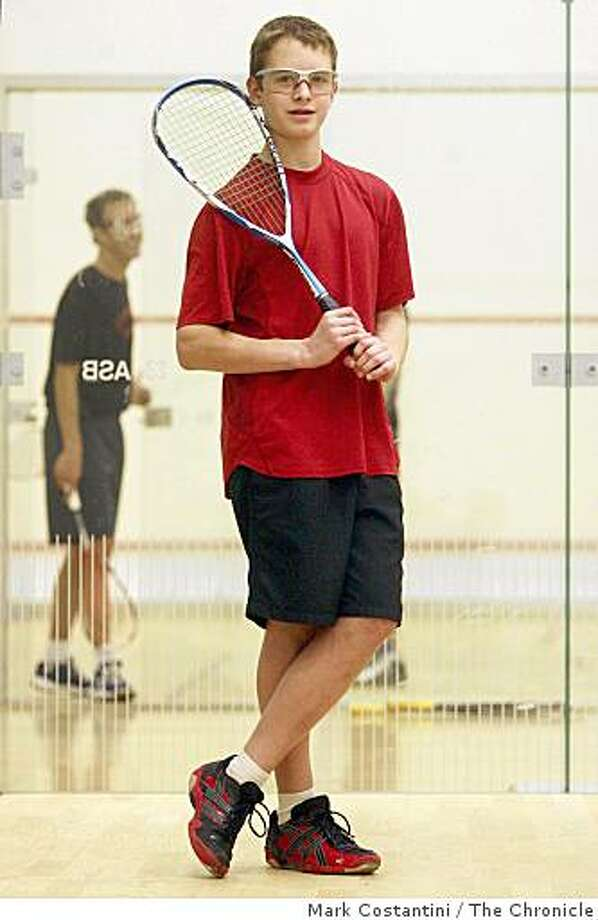 William Mohr, 15, in his squash gear holding his racket stands at a court at Stanford University in Palo Alto, Calif. on Wednesday, January 21, 2009. Photo: Mark Costantini, The Chronicle