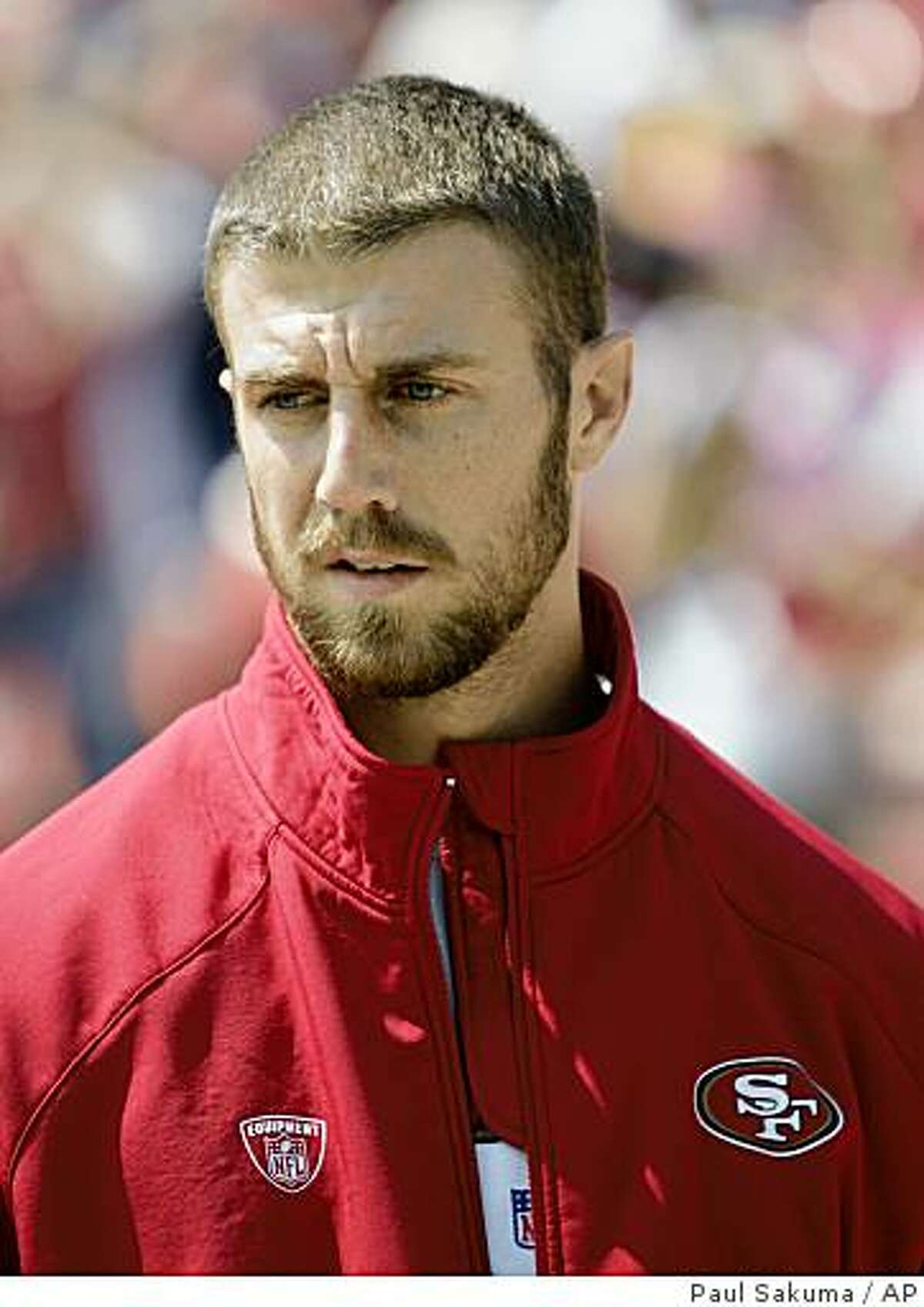 Injured San Francisco 49ers quarterback Alex Smith watches the game against the Arizona Cardinals in the first quarter of an NFL football game in San Francisco, Sunday, Sept. 7, 2008.