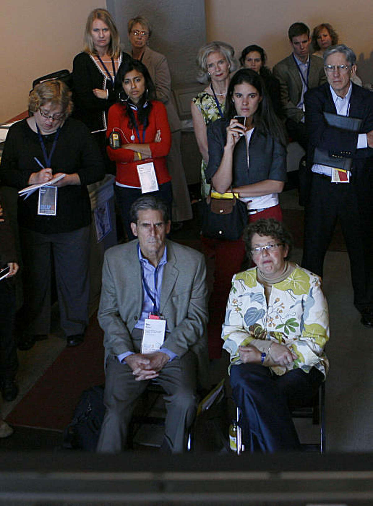 A crowd watches a television outside of Cowell Theater at the Fort Mason Center while a live television feed of Jacqueline Novogratz speaks from inside the theater during the Social Capital Markets 2010 conference (SOCAP 10) in San Francisco, Calif., on Monday, Oct. 4, 2010.