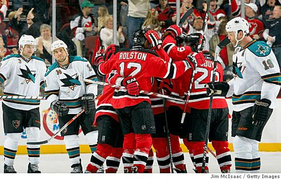 NEWARK, NJ - FEBRUARY 15:  Brian Rolston #12 of the New Jersey Devils celebrates with his teammates after setting up the game winning goal in the third period against the San Jose Sharks at the Prudential Center on February 15, 2009 in Newark, New Jersey. The Devils defeated the Sharks 6-5.  (Photo by Jim McIsaac/Getty Images) Photo: Jim McIsaac, Getty Images