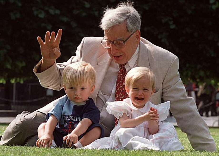"FILE- Professor Robert Edwards,  the British pioneer of IVF treatment, sits with two of his 'test-tube-babies', Sophie and Jack Emery who celebrate their second birthday in London in this file photo dated Monday July 20, 1998. Test-tube baby pioneer Robert Edwards of Britain has won the 2010 Nobel Prize in medicine it is announced Monday Oct. 4, 2010.  Edwards and some of his IVF test-tube children gatherd to celebrate the 20th anniversary of the birth of  Louise Brown, the world's first ""test tube"" babyborn in 1978. Photo: Alastair Grant, AP"
