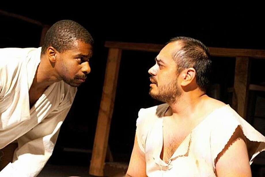 "Jesus (Charles Lewis III, left) confronts Judas (Kristoffer Barrera) in Custom Made Theatre's staging of Stephen Adly Guirgis' ""The Last Days of Judas Iscariot"" Photo: Jamie Buschbaum"