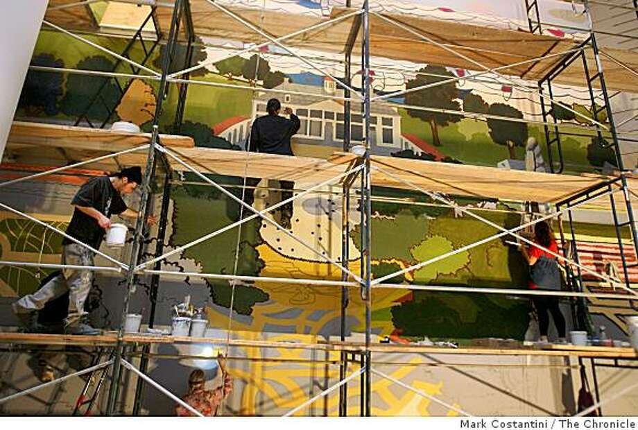 Mural painters paint a mural by artist Kerry James Marshall  in the SFMOMA lobby in San Francisco, Calif. on Friday, February 13, 2009. Photo: Mark Costantini, The Chronicle
