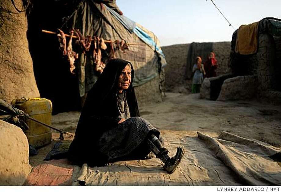 (NYT57) KABUL, Afghanistan -- Feb. 17, 2009 -- AFGHAN-CIVILIAN-DEATHS  -- An elderly woman who says she lost her leg in an American-led airstrike sits in a camp for displaced people on the outskirts of Kabul, Afghanistan, on Dec. 17, 2008. The number of civilians killed in Afghanistan rose by more than 40 percent last year over the previous one, according to a survey released on Tuesday by the United Nations, the latest measure of how the intensifying violence between the Taliban and American-led forces is ravaging the country. (Lynsey Addario/The New York Times) **MAGS OUT/NO SALES** Photo: LYNSEY ADDARIO, NYT