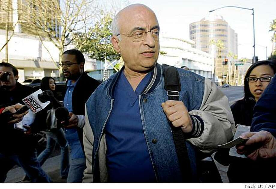 Followed by news reporters Dr. Michael Kamrava, 57, leaves his Beverly Hills, Calif. office on Monday, Feb. 9, 2009.  Kamrava's name emerged Monday as a result of an interview aired Monday on NBC with Nadya Suleman, who gave birth to eight babies Jan. 26. Kamrava is the director of the West Coast IVF Clinic. Photo: Nick Ut, AP