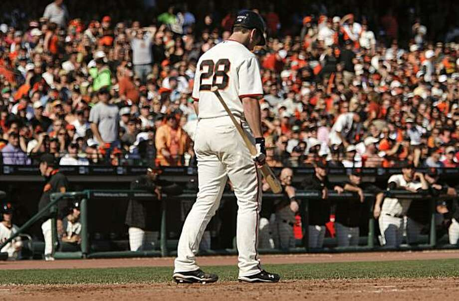 Giants catcher Buster Posey returns to the dugout after a called strike three by umpire Mike Everitt in the sixth inning against the Padres in San Francisco on Saturday. Photo: Michael Macor, The Chronicle