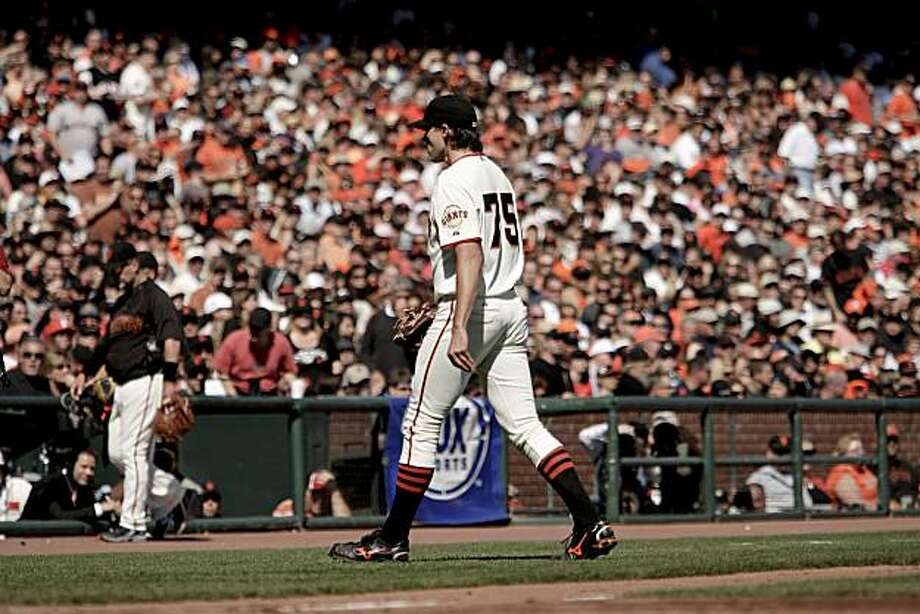 Giants starting pitcher Barry Zito leaves the game in the fourth inning with the score 4-0 San Diego in San Francisco on Saturday. Photo: Michael Macor, The Chronicle