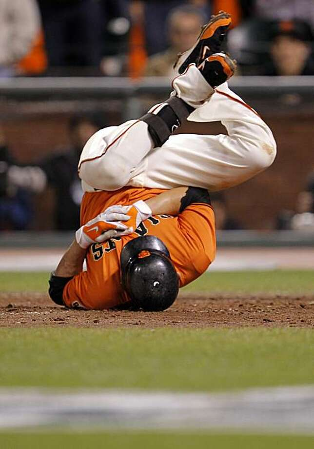 Freddy Sanchez rolls over in pain after being hit in the hand by a pitch in the bottom of the 10th inning as the San Francisco Giants take on the Atlanta Braves in Game 2 of the National League Divisional Series at AT&T Park in San Francisco, Calif., on Friday, October 8, 2010. Photo: Michael Macor, The Chronicle